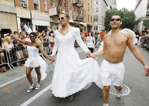 A man wears a wedding gown while marching in the Gay Pride Parade in New York